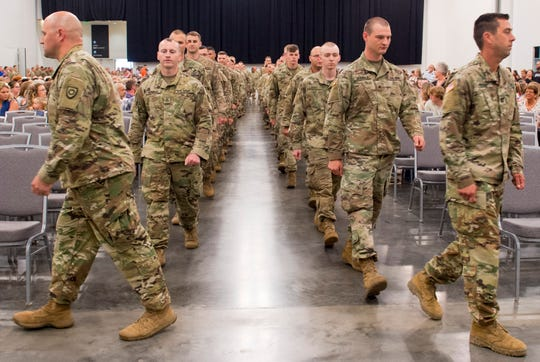 Soldiers with the 206th Engineer Battalion enter the Owensboro Convention Center for their departure ceremony Thursday, July 25, 2019.