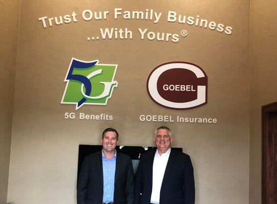 CEO/Owner of 5G Benefits Tony Goebel and President/Owner of Goebel Insurance & Financial Inc. Larry Goebel smile in the entryway of their new location at 131 Rolling N. Meadows Drive.