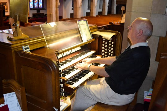 Curry plays the organ at Grace Lutheran Church, just as he once did in a little Swiss church during a European tour.