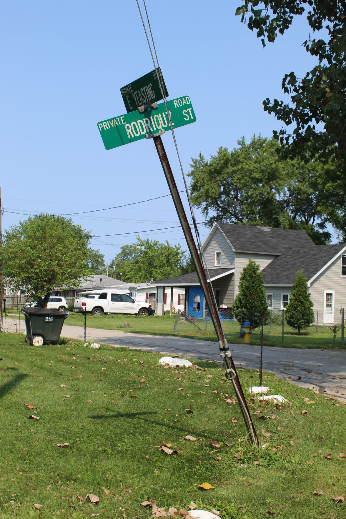 "The Rodriguez Street misspells the street name ""Rodriquz"" and leans precariously, symbolic of the problems that have plagued the 364-foot-long Madison Township road for decades."