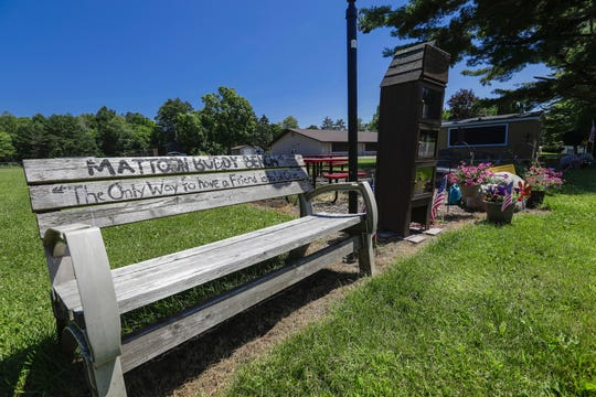 "The ""Matoon Buddy Bench""  near Mattoon Elementary School, visible in background."