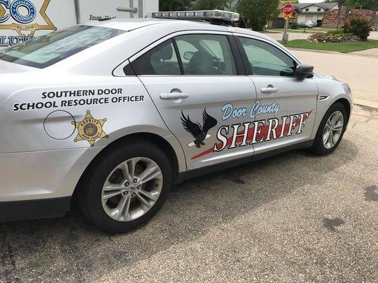 Southern Door's School Resource Officer's car, designed by Southern Door High School senior Abigail Neubauer.