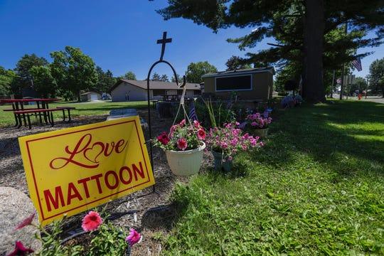 """A sign reading """"Love Mattoon"""" in  a garden near Mattoon Elementary School."""