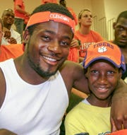Ray Ray McElrathbey, left, and his 11-year-old brother, Fahmarr, after Clemson football defeated Florida Atlantic on Saturday, Sept. 2, 2006.
