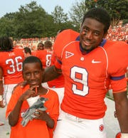 Ray Ray McElrathbey and his 11-year-old brother Fahmarr, left, after Clemson football defeated Florida Atlantic, Saturday, Sept. 2, 2006, in Clemson, S.C. Ray Ray, then 19-years-old with temporary custody of his brother because of his mother's continuing drug problems and his father's gambling addiction, became the source of national attention and support.