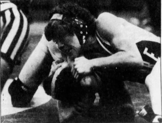 Nate Flesche, top, was a three-time state wrestling champion for Havre from 1987-89.