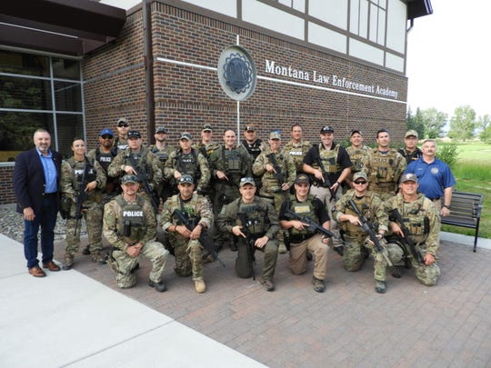 The Cascade County Sheriff's Office's SWAT team assembles outside the Montana Law Enforcement Academy.