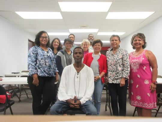 Author and instructor Walt F.J. Goodridge, and several of the attendees of Guam's first writers workshop. From left: Fadila K., Marie L., Sophie N., Tyrone B., Dianne S., Christopher A., Jeni Ann F., Kim B. and Dr. Sam M. Not shown: Rlene S. and Louise.