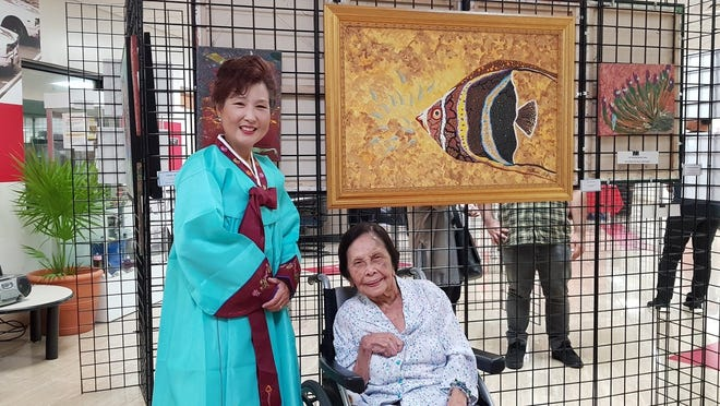 """Yeon Sook Park has worked with the seniors at the center through a grant from the National Endowment for the Arts and the Guam Council of the Arts and Humanities. """"There were two goals for the works by the seniors at the Guma Gine 'fli'e Center,"""" said Park. """"One is to provide a physical activity for the elderly and exercise their hand-eye coordination. The other is to hopefully help them create images of some of their memories so that they can be shared with friends and family."""""""