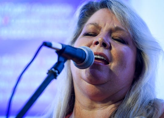 Song writer-performer Leslie Satcher belts out a tune at Hometown Roots on the first night of the 10th annual Sandy Lee Songfest held in downtown Henderson Wednesday, July 24, 2019.