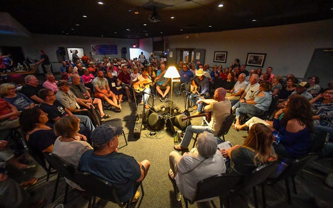 Like a great big living room, song writer-performers, left to right, Don Sampson, Wynn Varble and Rusty Tabor swap tales and sing songs at Rookies on the first night of the 10th annual Sandy Lee Songfest held in downtown Henderson Wednesday, July 24, 2019.