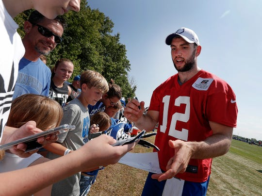 Indianapolis Colts quarterback Andrew Luck signs autographs for fans following their first day of their preseason training camp at Grand Park in Westfield on Thursday, July 25, 2019.