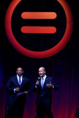 Democratic presidential hopeful John Delaney talks with the National Urban League Conference attendees at the Indiana Convention Center on Thursday, July 25, 2019. Marc H. Morial, President and CEO, National Urban League looks on.