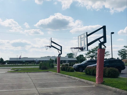 A couple of basketball goals decorate the parking lot of the Steve Alford All-American Inn.