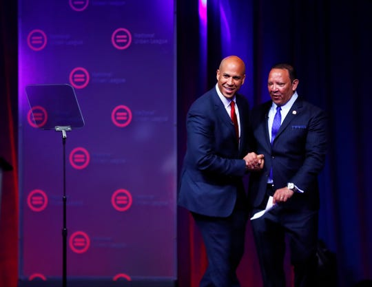 Marc H. Morial, President and CEO, National Urban League greets Sen. Cory Booker, Democratic candidate for president to the National Urban League Conference at the Indiana Convention Center, July 24, 2019.