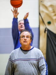Mike Ayers, 63, behind, and Greg Taggart, 63, front, shoot their daily 100 3-pointers at the Brown County YMCA.