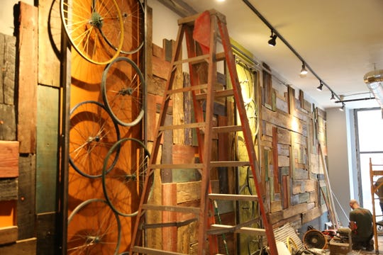 A contractor works on Bike Bar Ithaca.