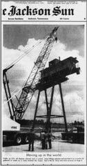 Newspaper clipping showing city signs raising the Casey Jone caboose on June 10, 1979
