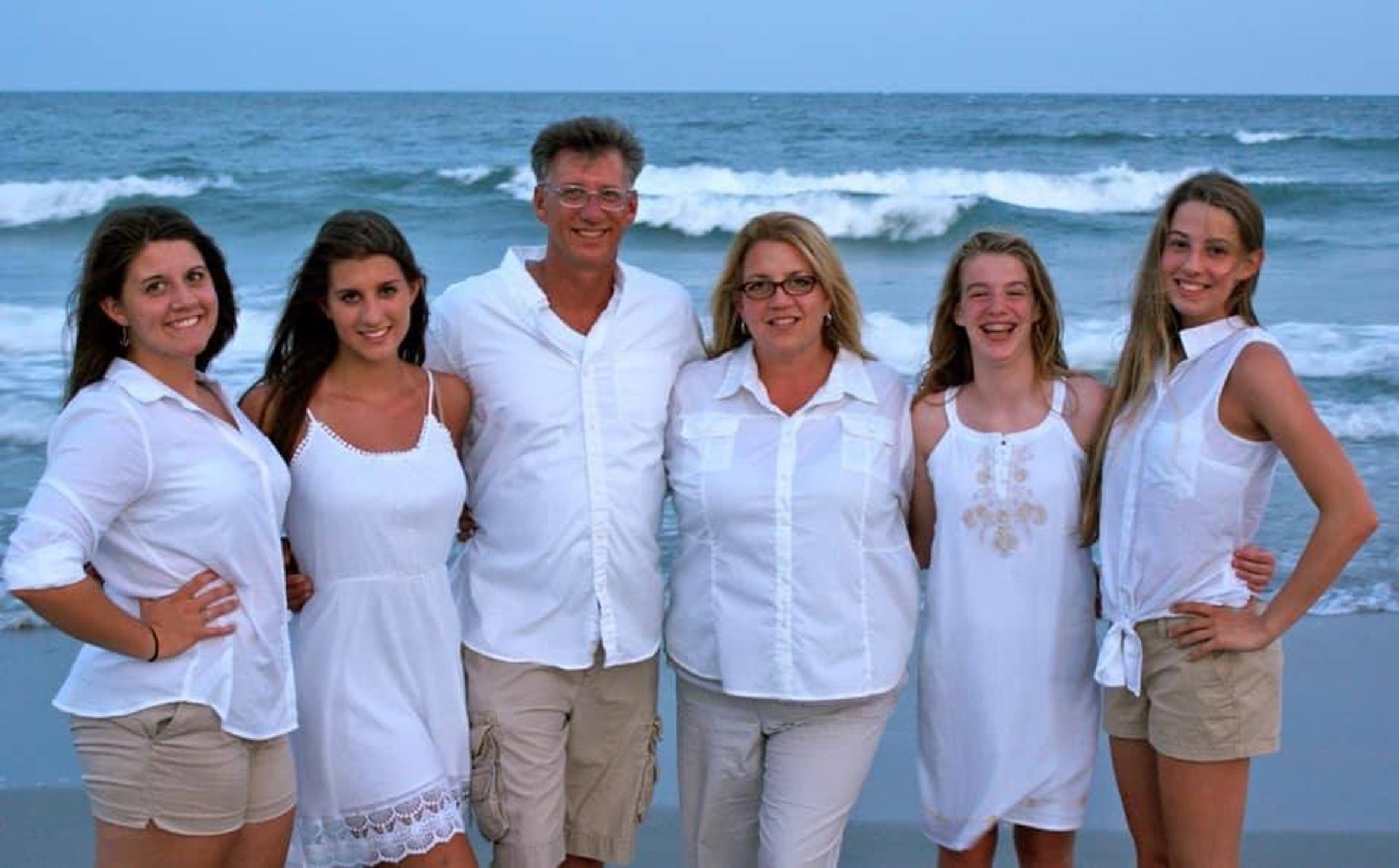 The Pepperman family poses on the beach during a vacation to Florida in 2018. Fred Pepperman, 53, died on July 14, after swimming out to rescue his daughters from a riptide at the Miramar Beach area.
