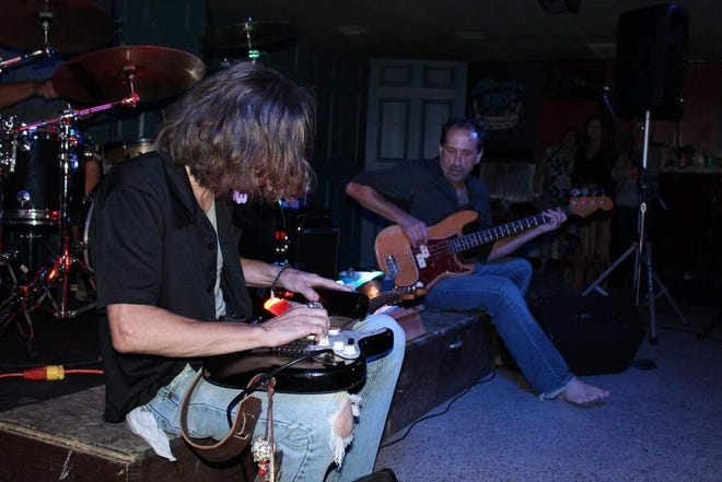 Michael Juan Nunez and Chad Willis rocking out with a bottle at the 2015 Mini Blues and Rock Festival, celebrating International Blues Day