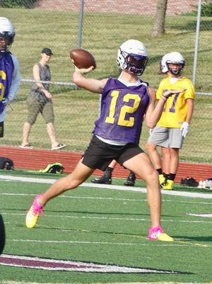 Bloom-Carroll senior quarterback Otto Kuhns gets set to fire a pass during a 7-on-7 passing scrimmage against Canal Winchester.