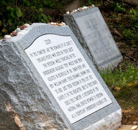 A new monument to runaway slaves who are buried in Pleasant Hill Cemetery was unveiled Thursday, July 25, 2019, in Rushville.