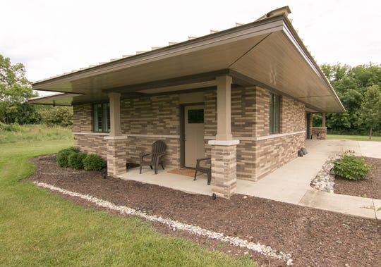 A guest house shown Tuesday, July 23, 2019, equipped with kitchen and full bath doubles as a secondary garage, capable of storing the Lewans' pontoon boat.
