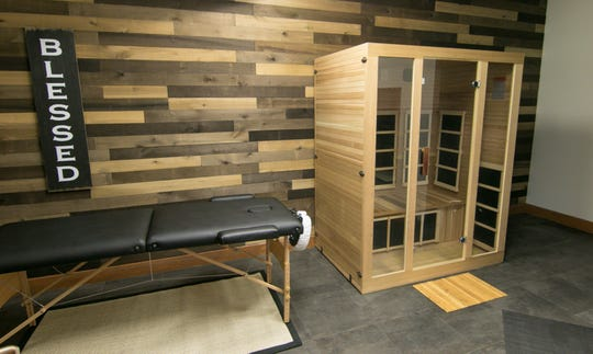 A steam sauna and massage area is decorated with planks of wood, shown Tuesday, July 23, 2019.