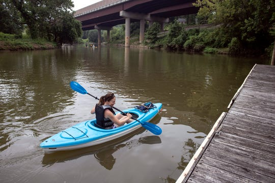Ali Miller enjoys a kayak ride on Harrods Creek near the Nachand Canoe and Kayak Rental in Prospect. July 18, 2019