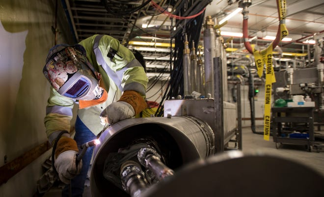 A welder works on specialized equipment inside the Facility for Rare Isotope Beams (FRIB) at Michigan State University Thursday, July 25, 2019.