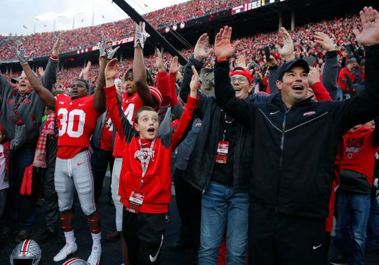 Ohio State's new head coach Ryan Day celebrates with the masses after last year's win over Michigan in Ohio Stadium.