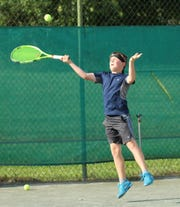 Philip Etzel extends himself to hit a shot in the boys 12 title match against Owan Gongwer in the 86th News Journal/Richland Bank Tennis Tournament at Lakewood Racquet Club.