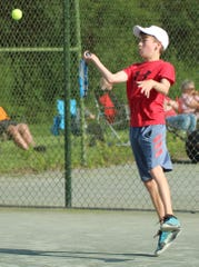 Owen Gongwer hits a forehand en route to a straight set victory over Philip Etzel for the boys 12 title in the 86th News Journal/Richland Bank Tennis Tournament at Lakewood Racquet Club.