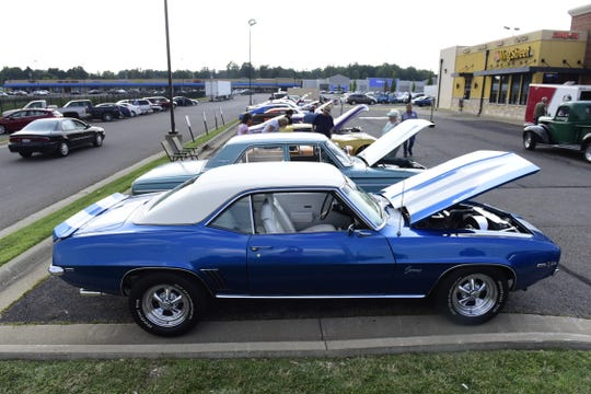 Nearly 100 classic cars filled the parking lot Thursday evening at the Ontario Pizza Hut.