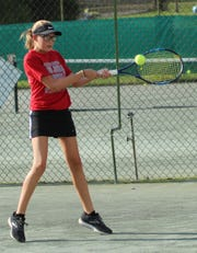 Malaina Wolfe his a backhand en route to a marathon victory over Noel Cline for the girls 12 title in the 86th News Journal/Richland Bank Tennis Tournament at Lakewood Racquet Club.