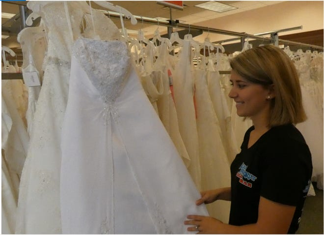 Riley Denes, 22, of Marengo, was looking for the perfect wedding dress Thursday at David's Bridal on Lexington-Springmill Road. Everything in the store is 40 percent off and the Ontario store is closing Sept. 22.