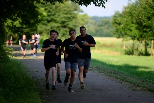 Members of the Clear Fork boys soccer team reach the final stretch of a two-mile run, the first leg of the Ohio Air National Guard's Herc Challenge.
