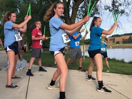MTC student Mary Wheeler lead a pre-run workout called Pound, which uses cardio and weight training using weights shaped like drumsticks in a rhythm.