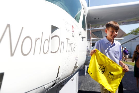 Reid, 12, a St. Jude patient and son of a FedEx Express pilot, has a Cessna Caravan named in his honor during a ceremony in partnership between FedEx and St. Jude Children's Research Hospital at the WGC-FedEx St. Jude Invitational at TPC Southwind on Thursday, July 25, 2019.