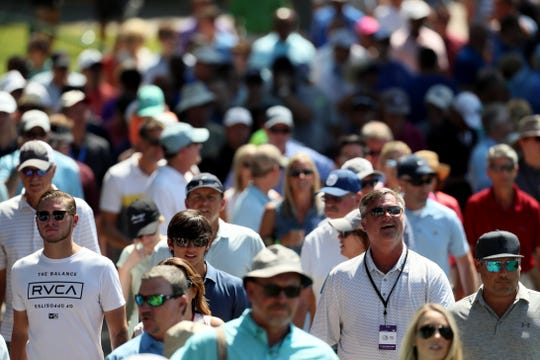 Fans follow the grouping of Rory McIlroy, Jason Day and Brooks Koepka at No. 9 at TPC Southwind on Thursday during the first round of the WGC-FedEx St. Jude Invitational.