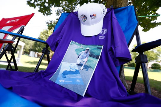 A picture is set on a chair on the 11th hole at TPC Southwind as a memorial to Dennis Taylor, who volunteered there for 36 years before passing away in June of this year.