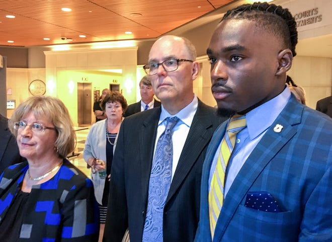 Former University of Wisconsin wide receiver Quintez Cephus, right, with his attorneys Kathleen Stilling, left, and Stephen Meyer after appearing in court  Aug. 23, 2018, in Madison.