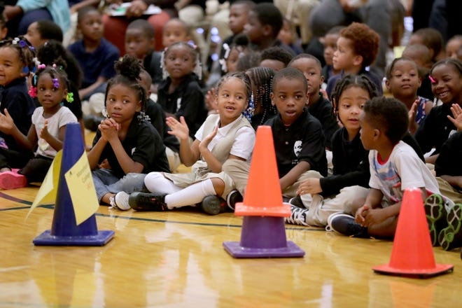 Dr. Martin Luther King Jr. Elementary students applaud during an assembly as they received backpacks for school supplies donated by area residents through the third annual No Empty Backpacks School Supplies Drive.