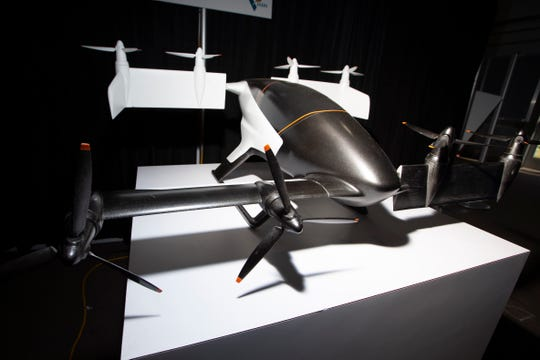 A model Airbus Vahana is on display at the Urban Air Mobility tent. Airbus is working the Vahana, a self-piloted, electric, single-seat, tilt-wing aircraft.