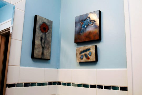 Artwork in the bathroom was done by artist Kathy Eggert.