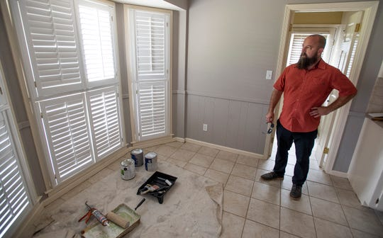Lee Thompson, of Conrex, checks on a renovation of a recently purchased home in Montgomery, Ala., on Thursday July 25, 2019. Conrex is a rental company that renovates houses and rents them out.