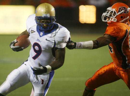 Tulsa's Charles Clay tries to turn the corner against Texas-El Paso defender Matt Ellis on Saturday, Oct. 6, 2007, in El Paso, Texas.