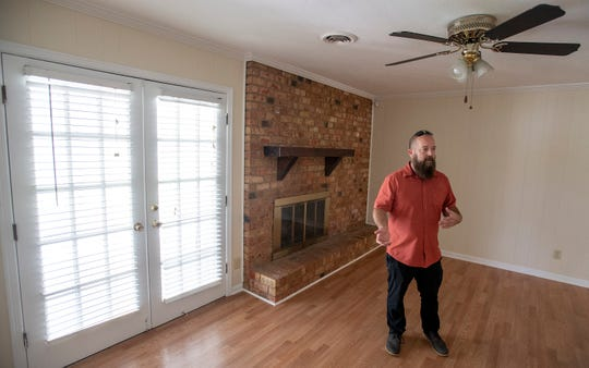 Lee Thompson, of Conrex, tours a recently purchased home in Montgomery, Ala., on Thursday July 25, 2019. Conrex is a rental company that renovates houses and rents them out.