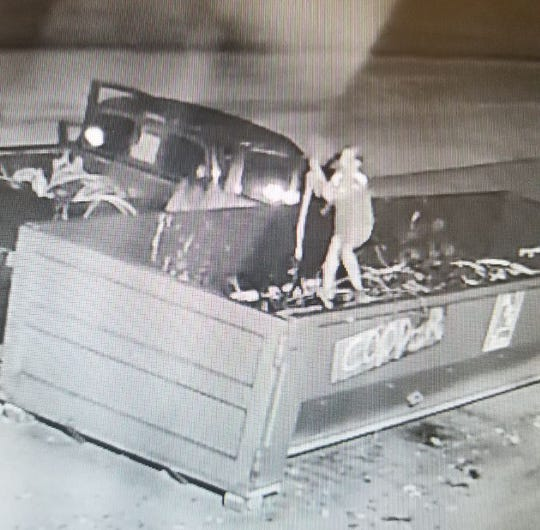 This photo, taken from a surveillance video, shows one of the suspects taking copper from a bin in Prattville.