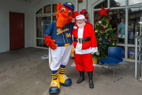 Montgomery Biscuits mascot Big Mo and Santa at Riverwalk Stadium in Montgomery. The Biscuits are having Christmas in July on Saturday.